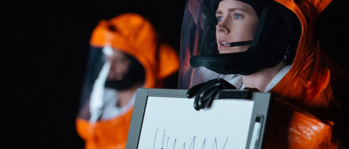 Female Scientist Holding Sign Reading 'Human'